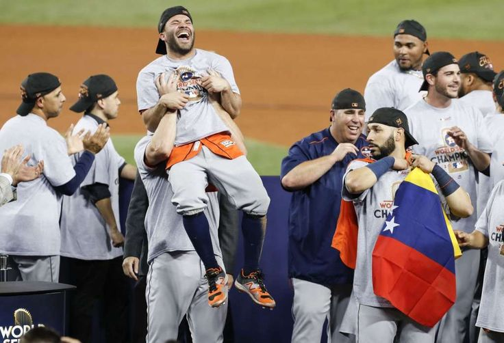 Houston Astros second baseman Jose Altuve (27) is hoisted in the air at the Houston Astros celebrate beating the Los Angeles Dodgers 5-1 in Game 7 of the World Series at Dodger Stadium on Wednesday, Nov. 1, 2017, in Los Angeles. The Astros took the Series 4-games-to-3 to capture the franchise's first title. Photo: Brett Coomer/Houston Chronicle