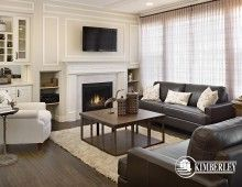 Great room, with built in shelves and custom millwork. That fireplace is a fabulous centrepiece to the space! The Amethyst plan, by Kimberley Homes, Edmonton #interiordesign #newhomedesign #homedesign #newhome #customhome #yegre #buildwithkimberley #kimberleyhomes #fireplace #greatroom #livingroom #bonusroom #accentwall