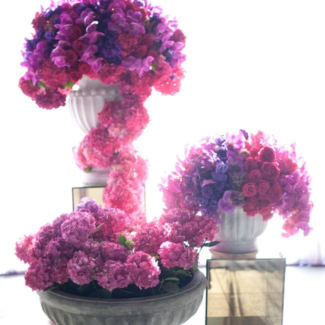 Pink and purple hydrangea, orchid and rose filled vases