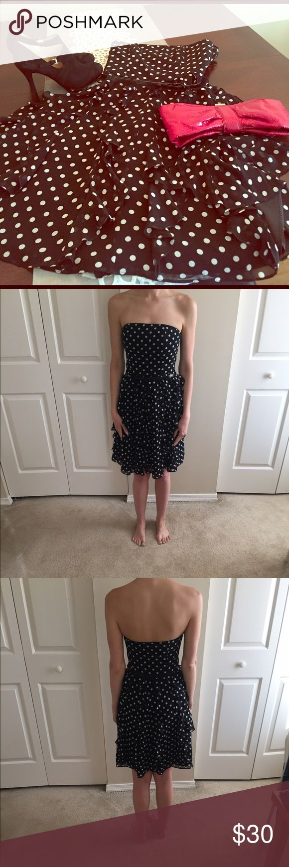Black House White Market size 0 occasion dress This is a strapless size 0 dress with black & white polka dots! Fun ruffle bottom makes this dress incredible for dancing! Would be perfect for any occasion to include weddings, showers, parties & more! White House Black Market Dresses Midi