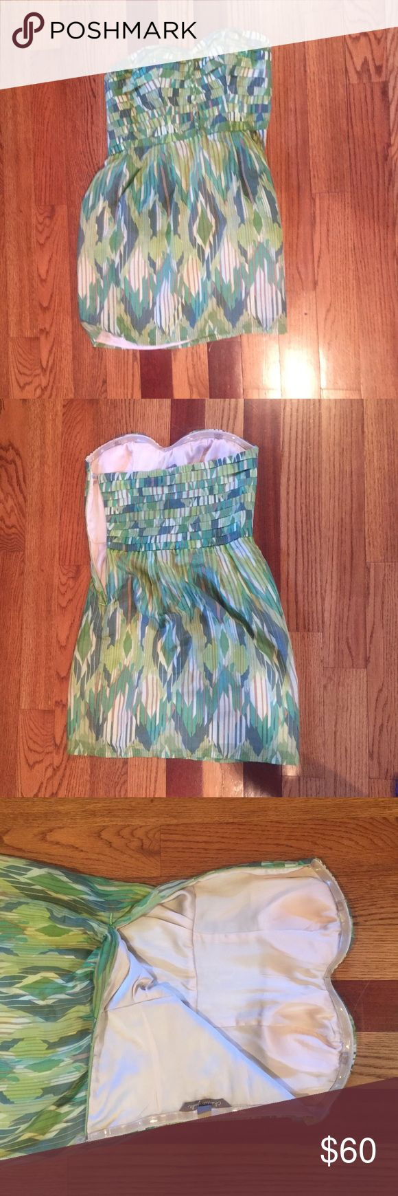 Green patterned strapless dress Cute and almost new green print dress. No trades! I'm open to negotiations and questions!! Charlie jade dress Urban Outfitters Dresses Strapless