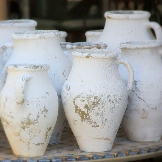 white jugs, pitchers. love the rustic look, something serene about these in white. I want some beside my fireplace!