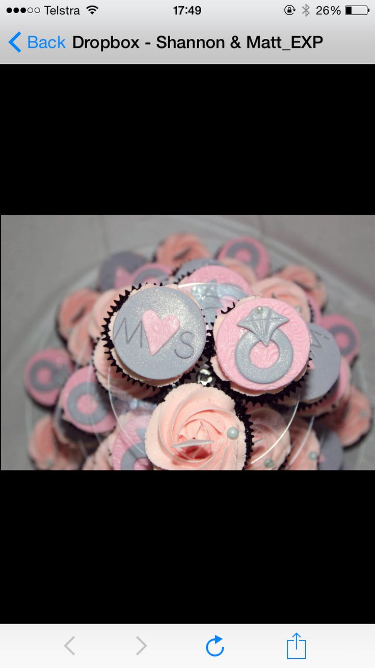 Engagement cupcakes created by Cupkates in Cairns with our initials and a ring :)