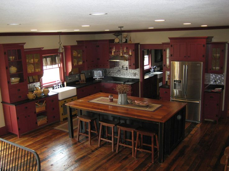 Love kitchen, island, & bar stools.  Not sure on the red and cabinets need to go to the ceiling.