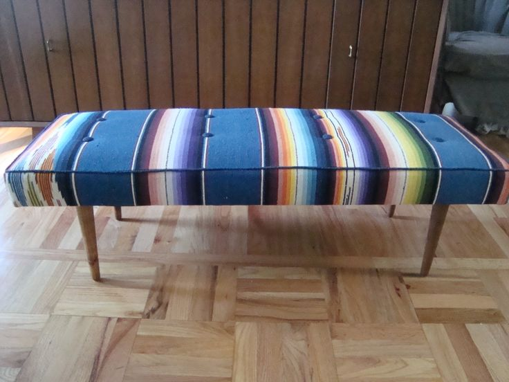Mid-century bench reupholstered in a vintage Mexican serape.  Also I refinished the legs with pure tung oil.  Turned out great!