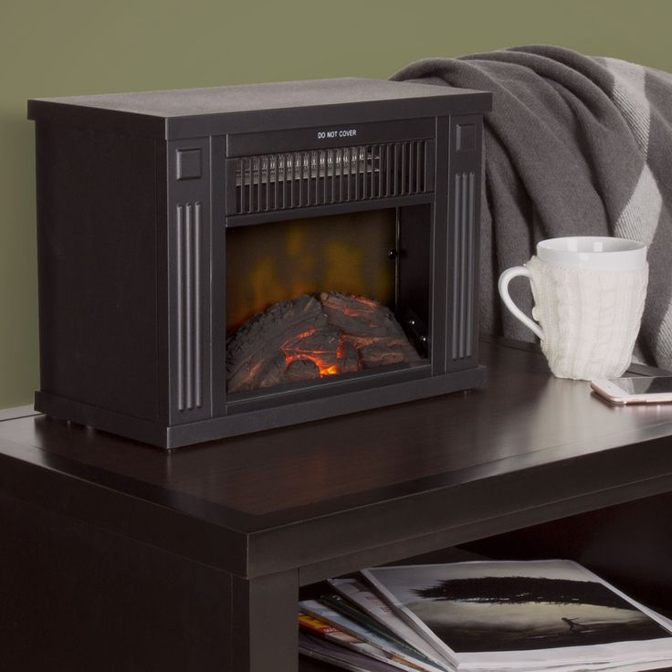 """Bring the beauty and warmth of a fireplace with you wherever you go with this compact Windsor Home 13"""" Portable Mini Electric Fireplace Heater in black. Now you'll be able to stay cozy any where in your home, office and more."""