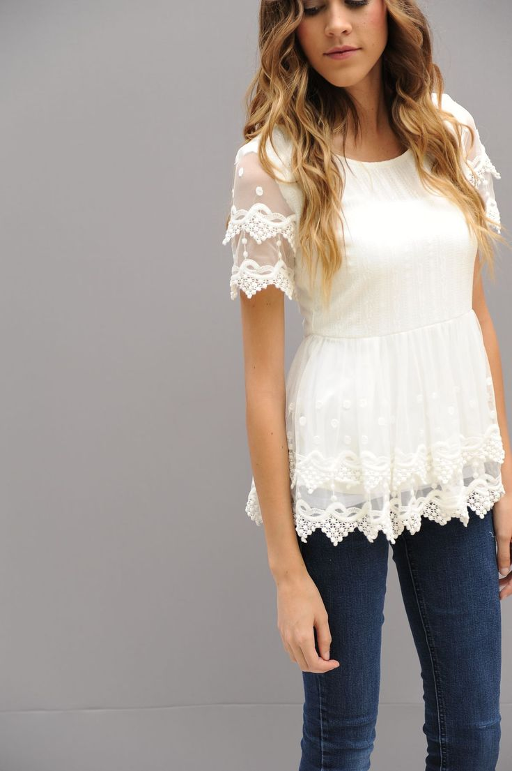 What more would a girl want then a peplum with lace! Double layer with dots. This top is so beautiful. Its a white lace. Lightweight and long. Everything is lined but the sleeves. 2 Laces are combined to make this top. It will be your new favorite go to shirt!