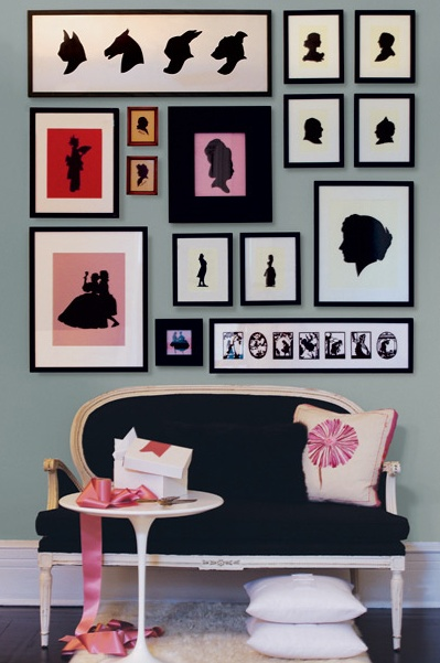 Settee is gorgeous and so it the set up of the art wall.