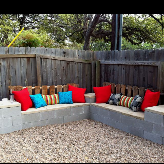 Cement Block Bench stucco With Some Pillows On Top It