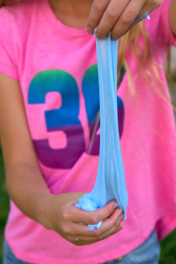 This is how to make laundry detergent slime at home with only 2 ingredients! Easy goo recipe that is made with glue, detergent, and any color you like.