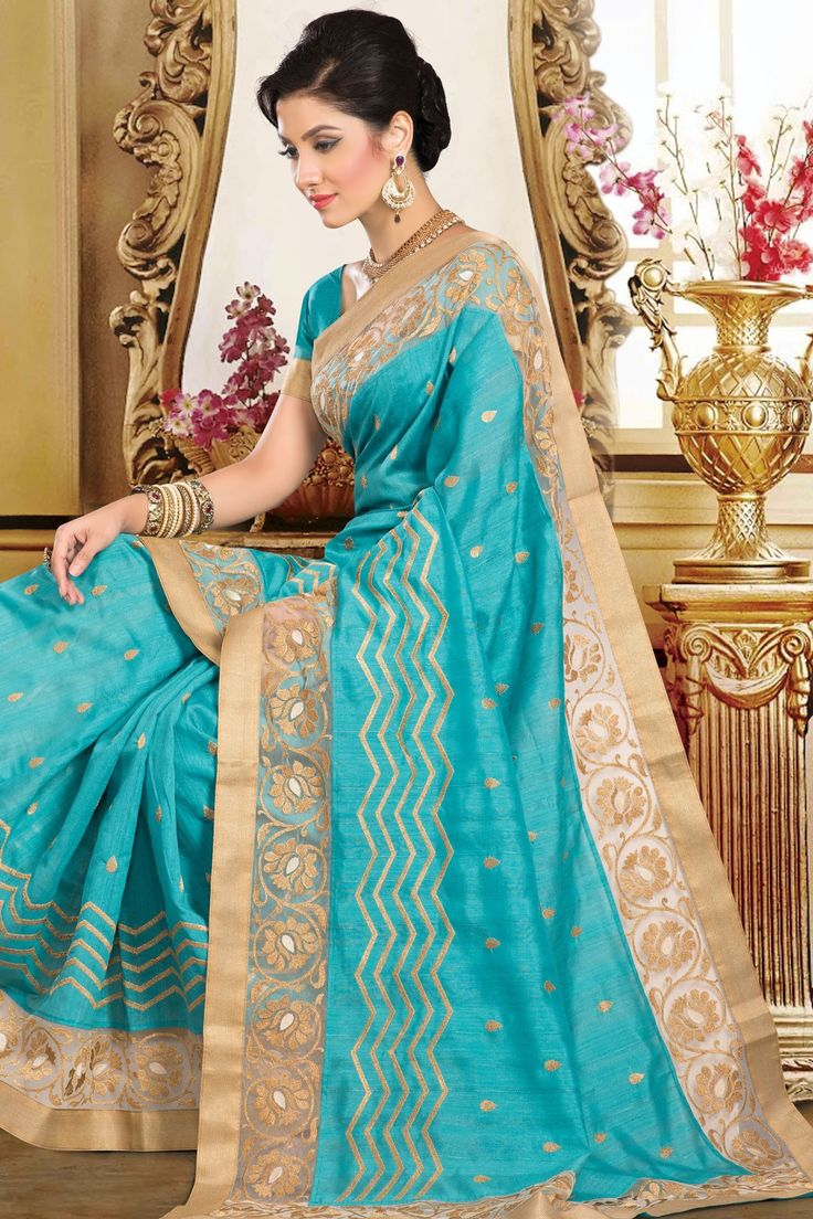 Blue gorgeous blended tussar saree with gold organza border.