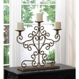 """ANTIQUED CANDELABRA (ea)Retail Price:$69.95 PRODUCT DESCRIPTION: Give your table a romantic makeover in an instant! this gorgeous candelabra is made from wrought iron and finished to look like a family heirloom. The scrolling metalwork rises to hold three candle platforms, ready for the candles of your choice. (slc)  UPC Number:849179015893  Material(s):CAST IRON  Dimensions: 23.5"""" x 5.38"""" x 20.8"""""""
