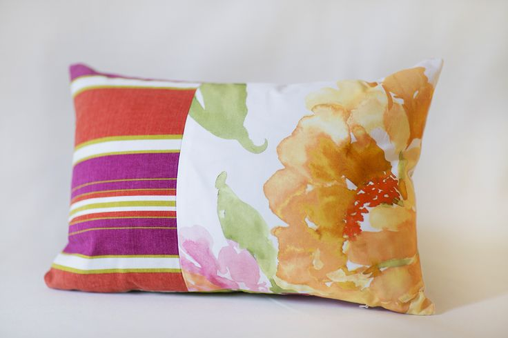 Handmade Pillow 	Size: 18 x 13 inch 	Up-cycled Fabric  Each piece has been thoughtfully designed and locally produced, by hand, primarily from resources diverted from the waste stream.   We hope you will LOVE your new accessories as much as we loved creating them for you!