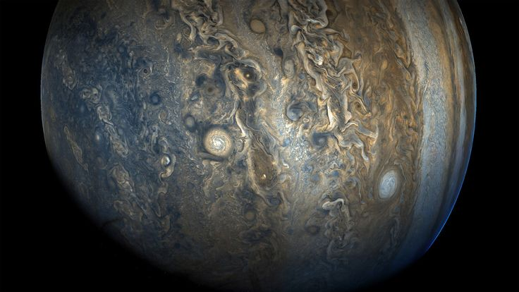 """See Jupiter's southern hemisphere in beautiful detail in this new image taken by NASA's Juno spacecraft. The color-enhanced view captures one of the white ovals in the """"String of Pearls,"""" one of eight massive rotating storms at 40 degrees south latitude on the gas giant planet."""
