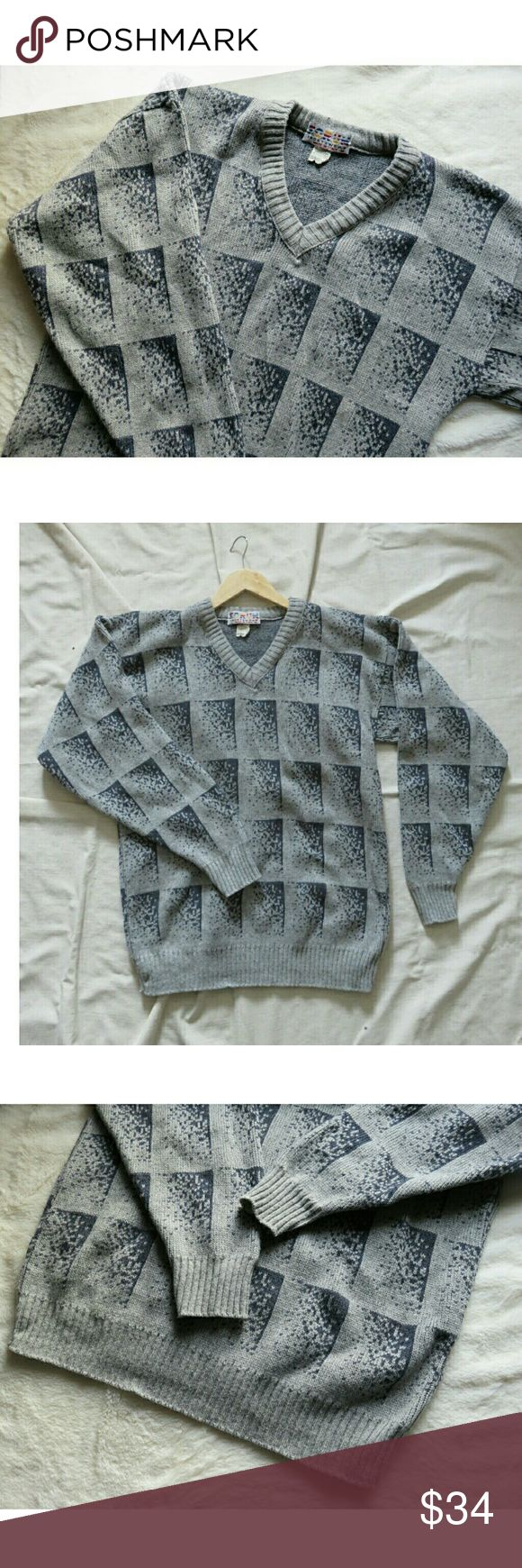 """Men's Vintage Italy Wool Sweater Gray Grid Med Awesome vintage sweater made in Italy from Forum Sportswear! All over grid/ geometric pattern in gray and white. V-neck, wide cuffs at sleeves. 60% wool, 20% acrylic, 15% polyester, 5% other yarns. Unisex, Size Men's Medium, Ladies oversized Medium/ Large. Measures lying flat approximately 21"""" across chest, 29"""" from shoulder to waist, and 24"""" from shoulder down sleeve to wrist. Excellent condition, like new! Consignment item. Ships fast! Thank…"""