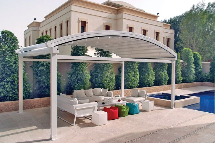 This is such an elegant outdoor space by the pool. During the day is the perfect place to lay down and relax, staying away of the UV light, and during the night the lighting system of the retractable roof gives you a romantic and comfortable environment.