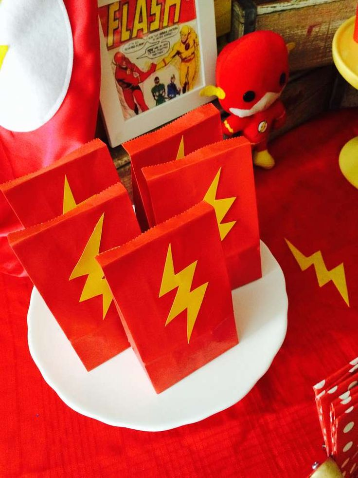Awesome favor bags at a Flash birthday party! See more party ideas at CatchMyParty.com!