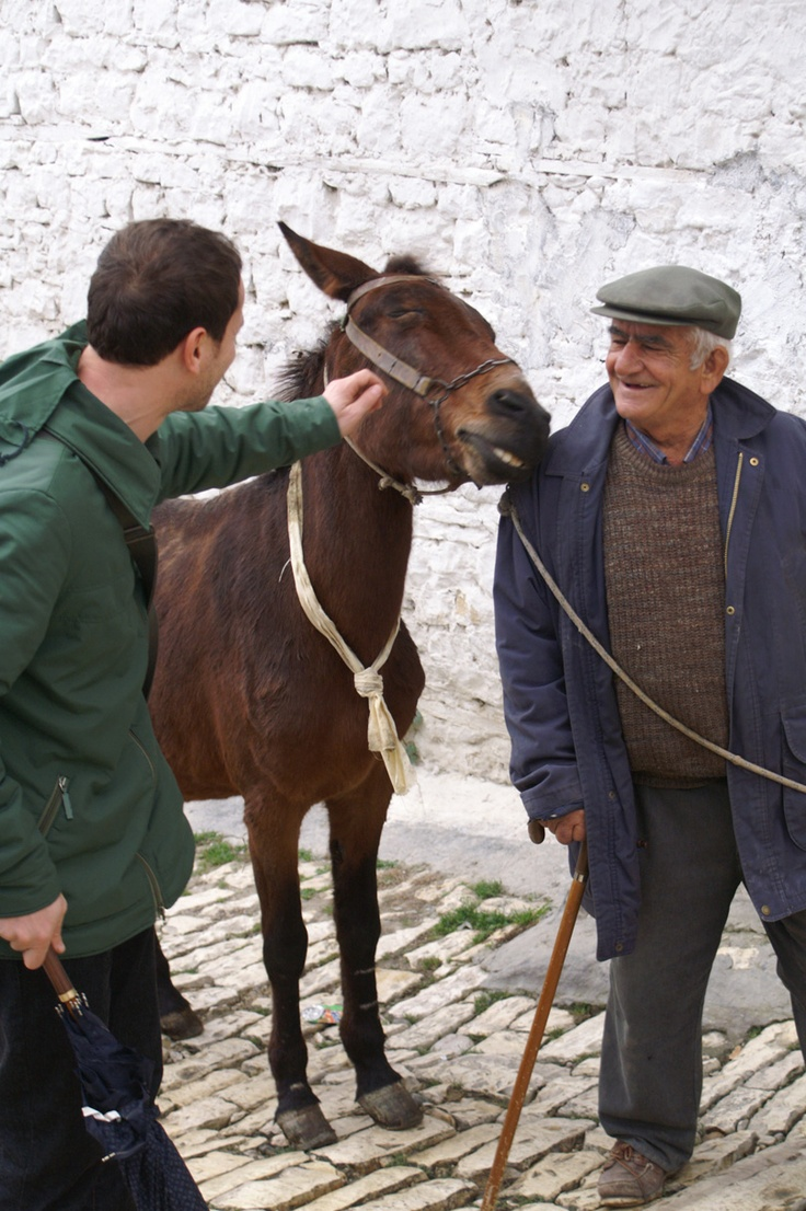 You can tell the old man just adores his little donkey :)