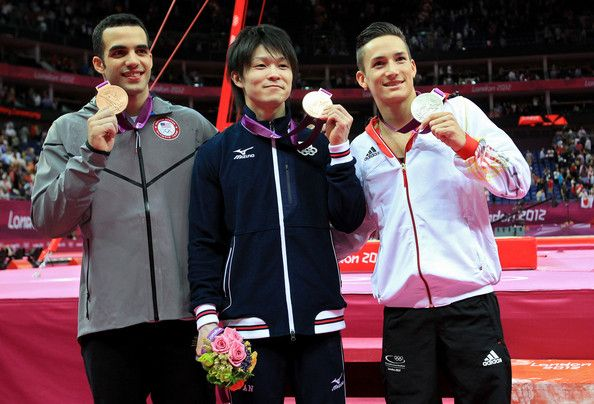 Gold medalist Kohei Uchimura (C) of Japan, silver medalist Marcel Nguyen (R) of Germany and bronze medalist Danell Leyva of the United States of America pose during the medal ceremont for the Artistic Gymnastics Men's Individual All-Around final on Day 5 of the London 2012 Olympic Games at North Greenwich Arena on August 1, 2012 in London.