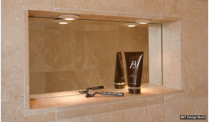 Mirrored wall niche in the shower