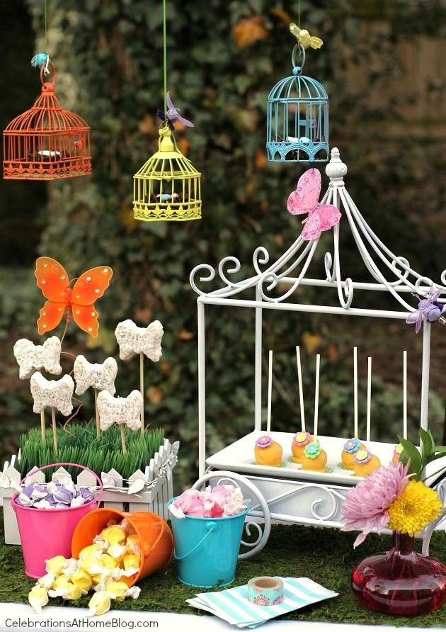 "Dessert table for kids garden party: hanging bird cages with chocolate ""nests"", ""butterfly"" garden, and pretty cake pops  #StylishKidsParties"