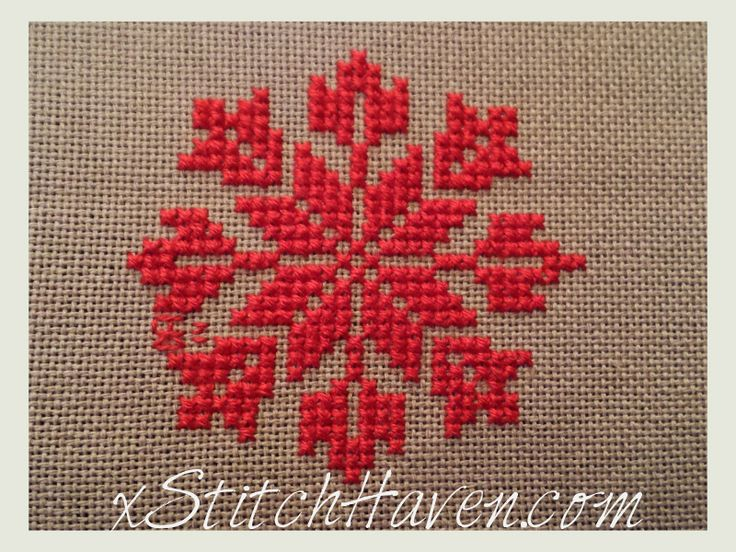 Ornament cross stitch! Snowflake xstitch, almost Scandinavian with the red colors.