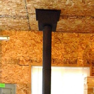 How to install chimney pipe through a flat ceiling can be done by any do-it-yourself homeowner. Transitioning from Rock-Vent insulated double wall Class A chimney pipe to black single wall stove pipe through a flat ceiling.