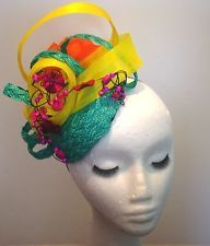 Designer Fascinator One of a Kind. A Multi Coloured Mint Yellow Orange Pink