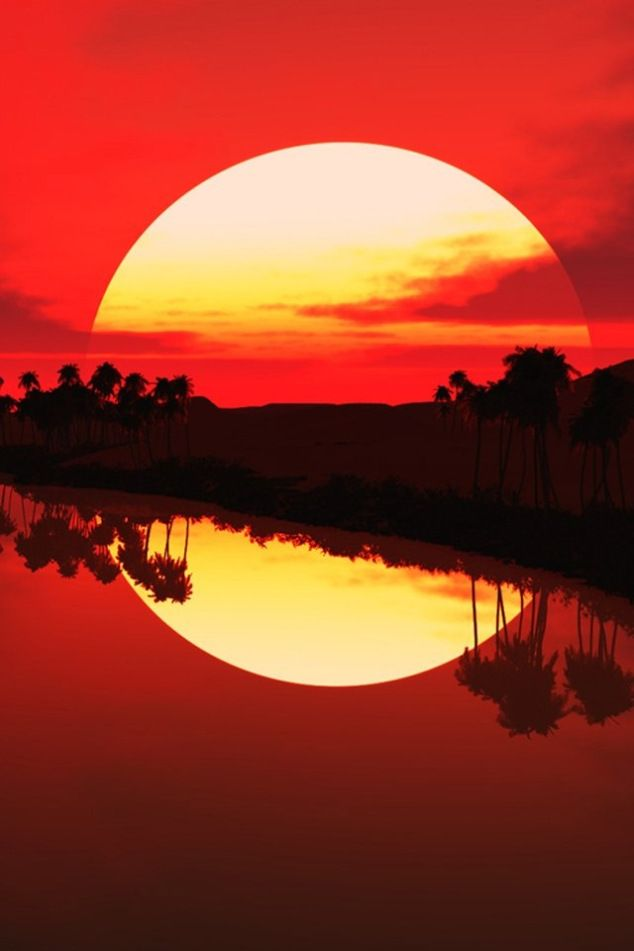Sunset. The heat distorts the image of the sun as it meets the horizon, throwing up a larger image that remains long after the sun has fallen.