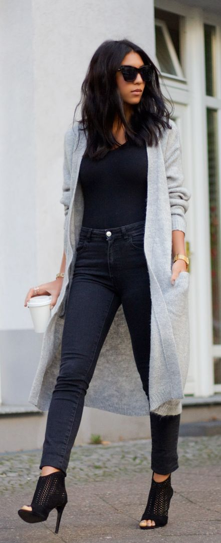 Kayla Seah is wearing a long grey cardigan from Gina Tricot
