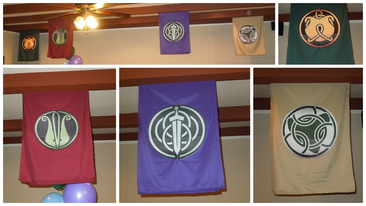 Brave clan tapestries hung for our daughters birthday. Logos are paper pinned to fabric.