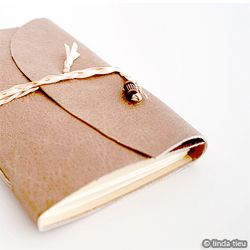 Beginner's bookbinding instruction on how to long stitch a journal together.