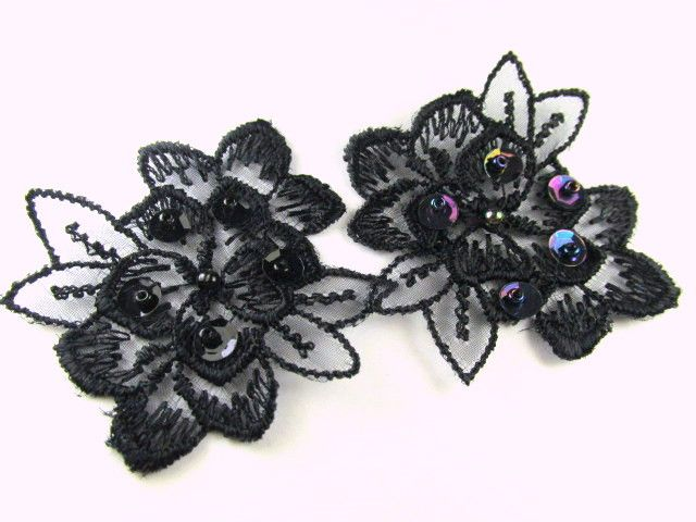 Black lace beaded and sequined flower appliques 2 inches x 1.75 inches. Each petal has a black sequin with a black bead in the center. Quantity 2