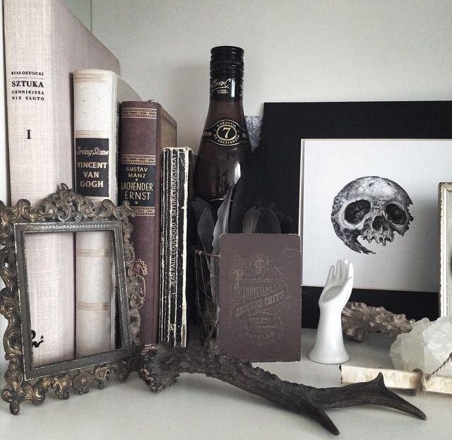 Bedroom decorations - vintage picture frame, old books, skull drawing.