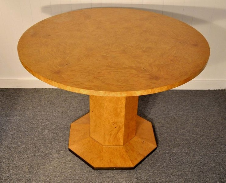 John Widdicomb games table. Burl wood (probably olive ash or olivewood veneer) round top with octagonal pedestal base, banded in copper or brass. Original label attached. On Kijiji Montreal.