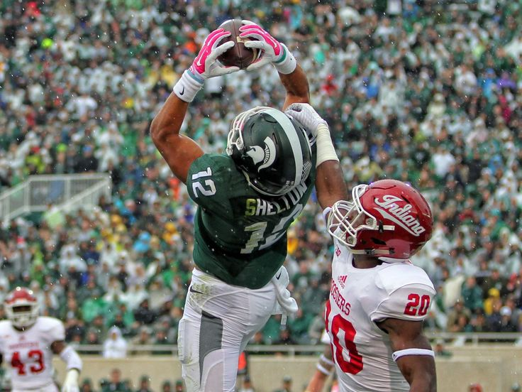 Michigan State receiver R.J. Shelton (12) hauls in a 22-yard touchdown catch against Indiana defender Jameel Cook Jr. (20) during the first half in East Lansing. Shelton added a second score to help the fourth-ranked Spartans win 52-26.  Mike Carter, USA TODAY Sports