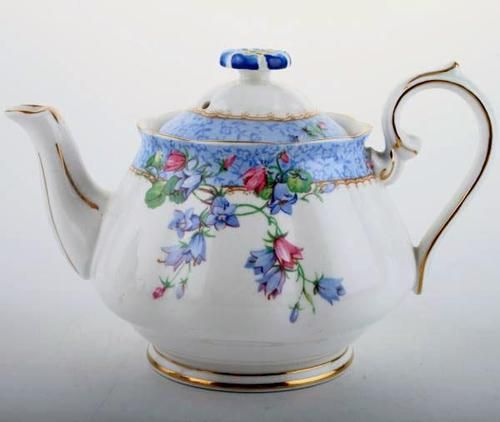 Lovely blue and white teapot with flowers.