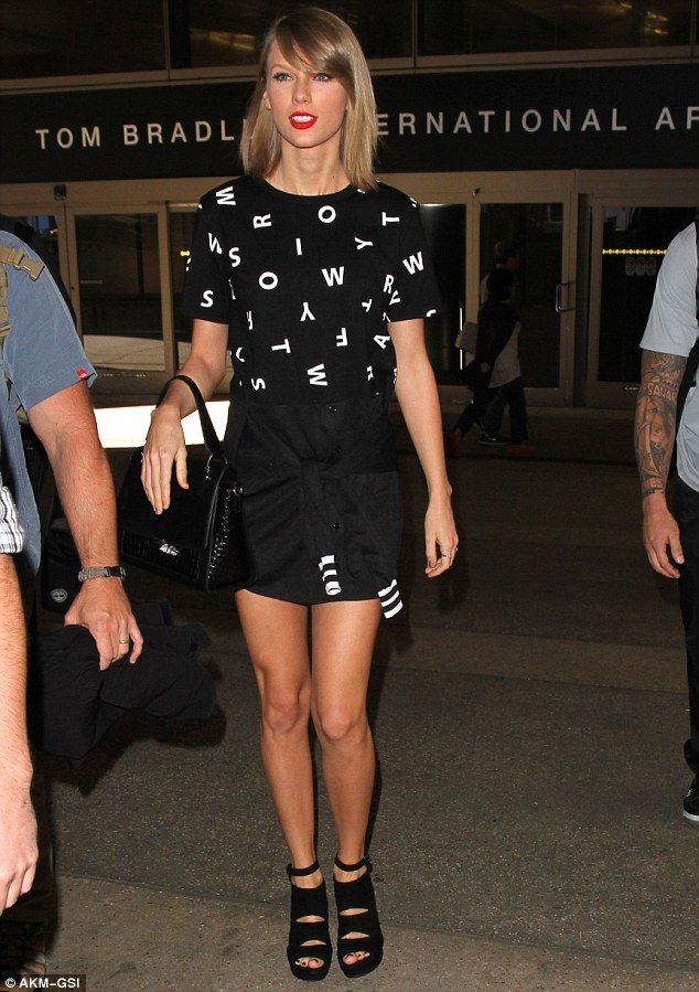Shake it off: Taylor Swift was spotted leaving Los Angeles International airport on Friday, after a long flight from China