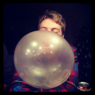 blowing a big bubble with bubble gum