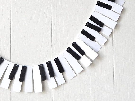 Piano Garland / I could see doing something similar with blue, red and white streamers for the harp!