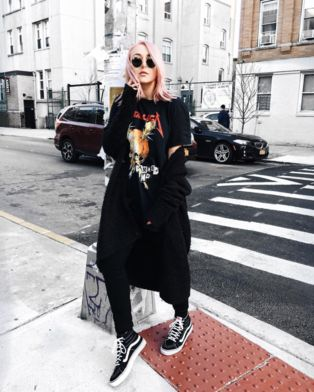 Fashion blogger, Nicole Alyse strolling through the city in a pair of Sk8-Hi Slims.