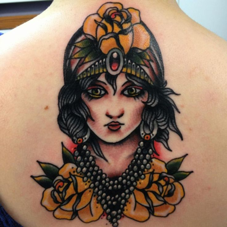 tattoo old school / traditional nautic ink - doll face / pinup with yellow flowers (by Joe Ellis)