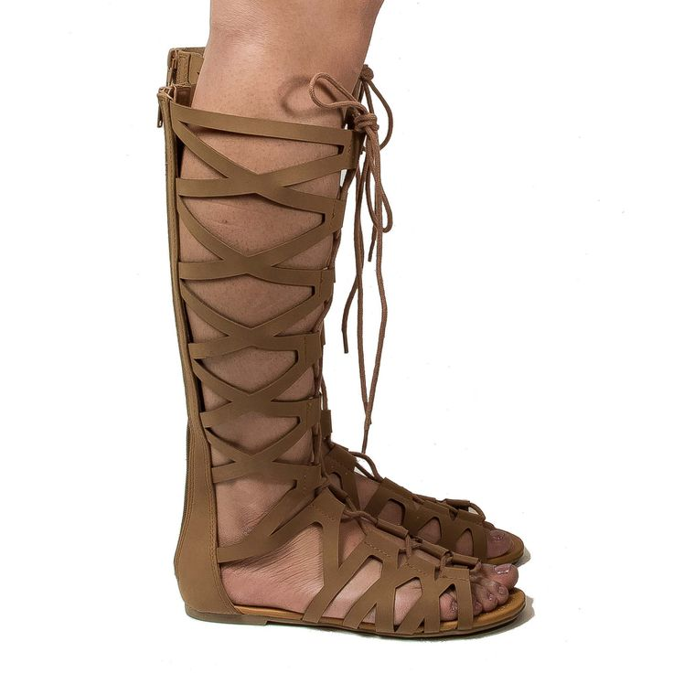 Be a trend setter with these gladiator inspired lace up flat sandals, featuring an open toe, contrast stitching, corset lace up feature, a gladiator laser cut out look, a back center zipper for easy w
