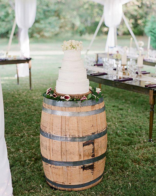 15 Wine Barrel Wedding Details: Cake Stand   SouthBound Bride   http://www.southboundbride.com/15-ways-to-use-wine-barrels-in-your-wedding-decor   Credit: Melissa Schollaert via Southern Weddings