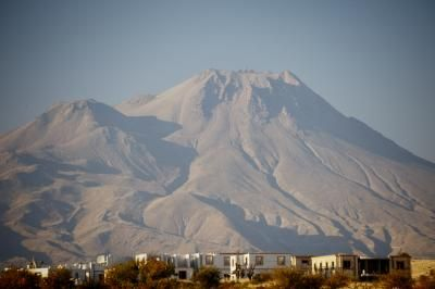 The Hasan Dagi volcano has two peaks towering over the rectangular homes in the valley below. The region around Hasan Dagi, in what is today Turkey, has been inhabited for more than 9,000 years. Photograph by Janet C. Harvey, Public Library of Science, EXPLOSIVE EVIDENCE FOR THE WORLD'S OLDEST MAP  01/15/2014·bycarylsue·inCurrent Event Connection,Geography In the News,Main.·  SCIENCE  A new study of volcanic rocks suggests that an ancient mural may indeed depict an erupting volcano…