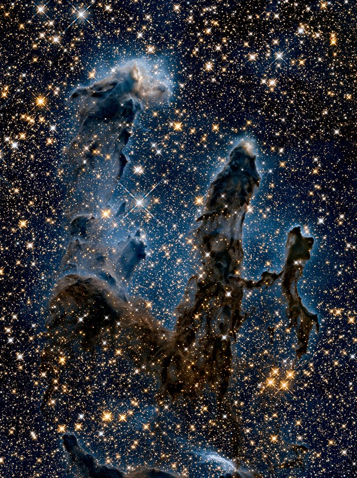 Hubble's new view of iconic 'Pillars of Creation' - space - 06 January 2015 - New Scientist