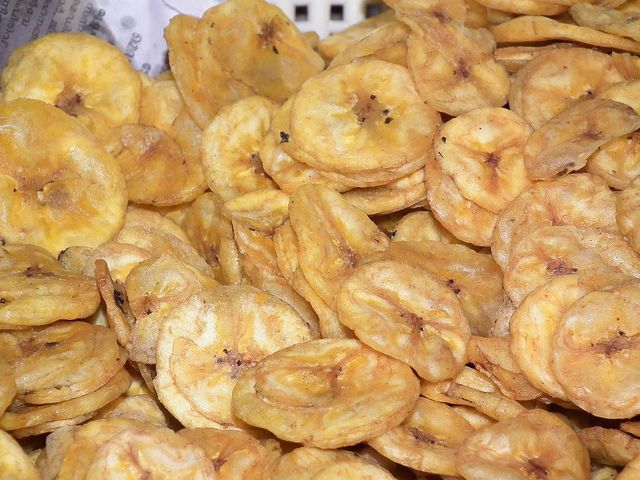 DIY Banana Chips | Banana chips are a cheap and easy snack that are great with a number of foods.  Eat them in the morning with your cereal, mix them with your favorite granola or trail mix blend, or eat them plain as a snack.  You can make these banana chips in a dehydrator or bake them in a low oven.  Before placing the bananas in the oven, they are brushed with a honey lemon syrup to help caramelize the banana.  DIY banana chips are a sweet treat that are good and good for you
