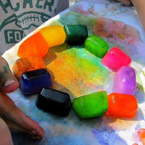 Ice painting...could also slide it down a slide on paper
