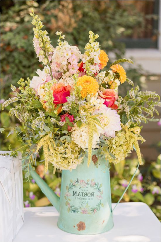 Wild flowers in a watering can, rustic wedding decor. Visit www.rosetintmywedding.co.uk for bespoke wedding planning and design.   ♡♥♡♥♡ this idea