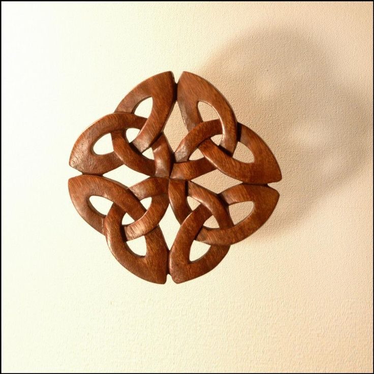 Celtic Knot is a very intricate piece of carving. The design features four trinity knots meeting at a central point.  Measures: 5 ½  x 5 ½  inches  Made from hand carved mahogany and polished with a special wax which will last a lifetime.   - See more at: http://www.irishongrand.com/gifts/for-home/for-wall/bf/celtic-knot-pid-25964#sthash.XMga4wpt.dpuf